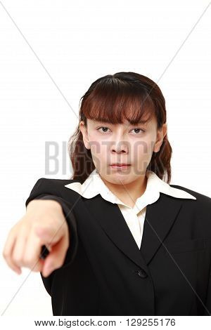 portrait of Asian businesswoman scolding on white background