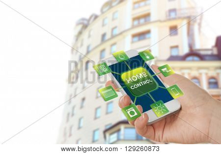 Using smart home app on phone. Smart home control concept.
