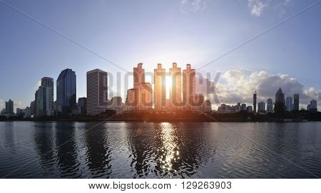 Building On The Early Morning Light Of Benjakiti Park In Bangkok, Thailand.