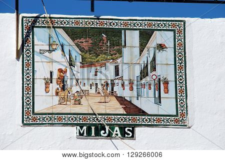 MIJAS, SPAIN - JUNE 14, 2008 - Ceramic tiled village street picture on the bullring wall Mijas Malaga Province Andalucia Spain Western Europe, June 14, 2008.