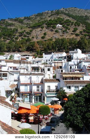MIJAS, SPAIN - JUNE 14, 2008 - Elevated view of a pavement cafe in the Plaza Virgen de la Pena with the Ermita del Calvario on the hillside to the rea Mijas Malaga Province Andalucia Spain Western Europe, June 14, 2008.