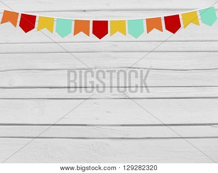 Brazilian june party festa junina mockup. Birthday or baby shower mockup scene. String of paper flags. Party decoration. White wooden background empty space. Top view.