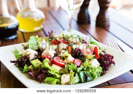 Greek Mediterranean salad with feta cheese tomatoes and peppers. Mediterranean salad. Mediterranean cuisine. Greek cuisine.
