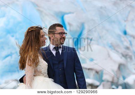 Bride And Groom  Posing Near Glacier