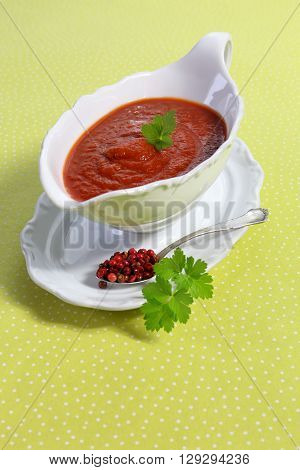 Tomato sauce in gravy boat red pepper and parsley