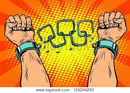 Freedom arms breaking the chains of slavery pop art retro style. Human rights. The struggle for freedom. Prisoner breaks the chain