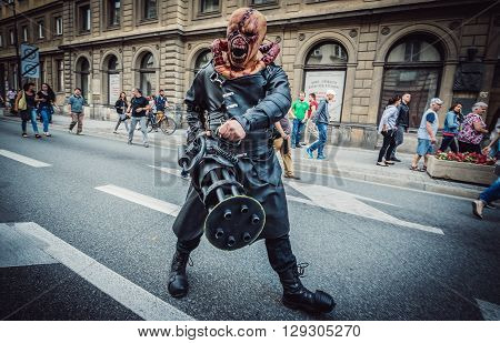 WARSAW, POLAND - JUNE 27 2015: Man dressed as Nemesis from Resident Evil video game duriing the 9th Zombie Walk walks on street in Warsaw city center