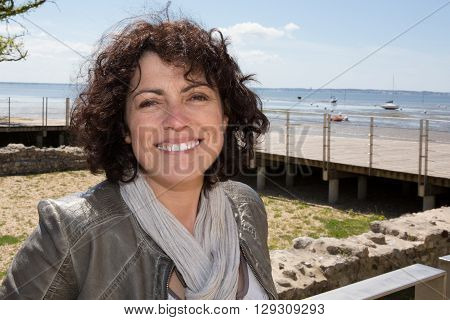 Cheerful Smiling Brunette Midle Aged Woman Outdoors