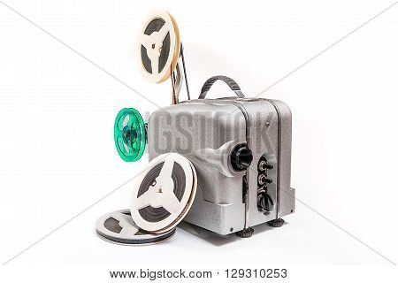 Vintage Motion Picture Film Projector And Reel Of Motion Picture Film Isolated On A White Background