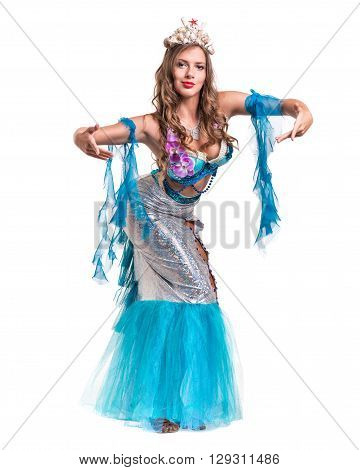 Carnival dancer girl dressed as a mermaid posing, isolated on white background in full length.