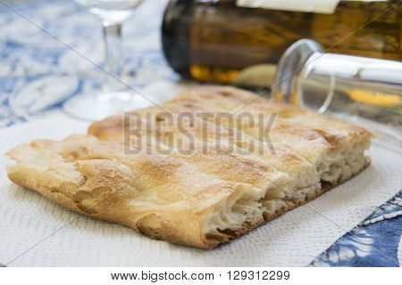 white pizza on a table with a tankard of beer and an empty bottle