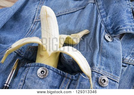 peeled banana in the breast pocket of a denim jacket
