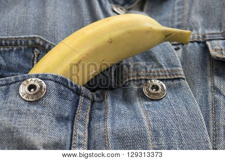 ripe banana in the breast pocket of a denim jacket