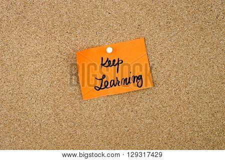 Keep Learning Written On Orange Paper Note