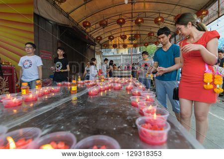 Bangkok Thailand - March 6 2016 : Thai people pray in temple at Wat Mangkon Kamalawat (Wat Leng Noei Yi). Wat Leng Noei Yi is the most important Chinese Buddhist temple in Bangkok Thailand.