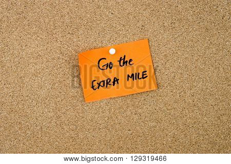Go The Extra Mile Written On Orange Paper Note