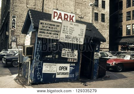 New York City USA - April 15 1985: Old parking with a dilapidated office in Manhattan in the 80s