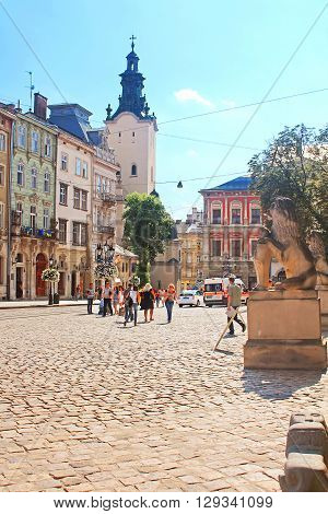 LVIV, UKRAINE - JULY 17, 2015: Market square - historical and tourist centre of the town in Lviv, Ukraine. It is UNESCO World Heritage Site