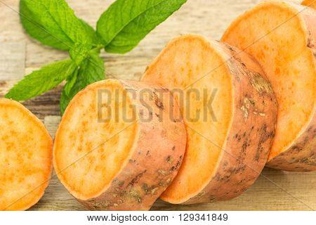 Fresh Sweet Potato Sliced Closeup , On Wooden Background