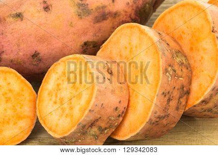 Fresh Sweet Potatoes Whole And Sliced Closeup