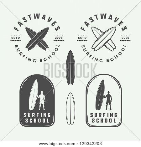 Set of vintage surfing logos emblems badges labels and design elements. Vector Illustration