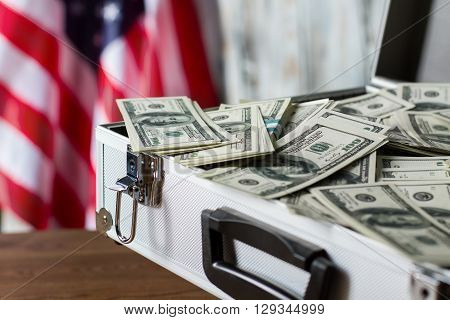 Pile of dollars in suitcase. USA flag, cash and case. More chances for victory. Compliment from local executive.
