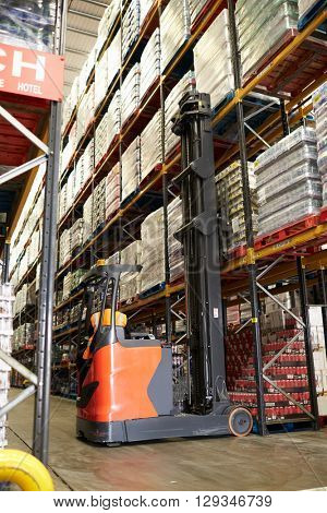 Moving stock in a warehouse with an aisle truck, vertical