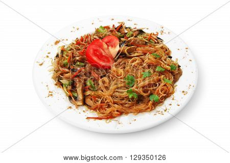 Asian food. Fried Thai glass Rice noodles with mushrooms and vegetables. Vegetarian Chinese transparent glass rice vermicelli fried with meat, parsley and tomatoes. Korean funchoza cellophane noodles.