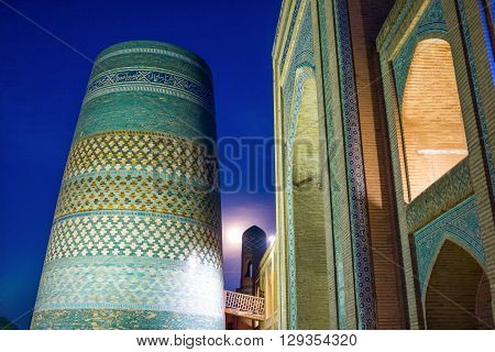 Uzbekistan Khiva night view of the Kalta Minor minaret at Muhammad Amin Khan Madrassah poster