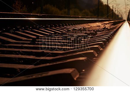 junction of railways track in trains station against  beautiful light of sun set sky use for land transport and logistic industry background , backdrop, copy space theme