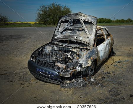 Abandoned car torched set on fire and burnt out
