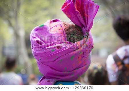 NEW YORK - APR 30 2016: Close up of a mans traditional pagri or turban at the Holi Hai Festival of Colors in Dag Hammerskjold Plaza hosted by NYC Bhangra in New York on April 30, 2016.