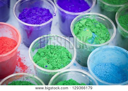 NEW YORK - APR 30 2016: The colorful powder in cups used to celebrate Holi Hai at the Festival of Colors celebration in Dag Hammerskjold Plaza hosted by NYC Bhangra in New York on April 30, 2016.