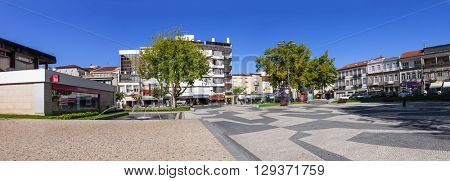 Vila Nova de Famalicao, Portugal. September 06, 2015: Dona Maria II Square in Vila Nova de Famalicao. Shopping Town entrance in the tall building. Braga, Portugal.