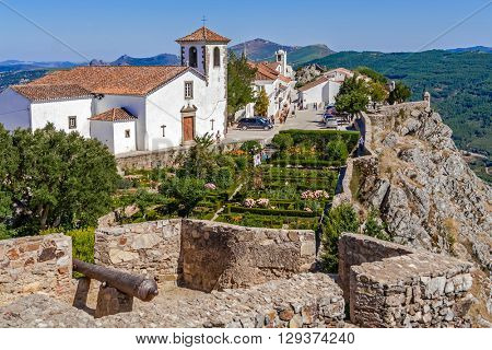 Marvao, Portugal. July 24, 2015: View of the village, Santa Maria Church and garden from the castle tower. Alto Alentejo, Portugal. Marvao was a candidate to World Heritage Site by UNESCO.
