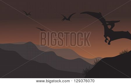 Silhouette of pterodactyl fly at the night with brown backgrounds