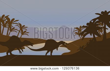 Silhouette of dinosaur in lake at the sunset