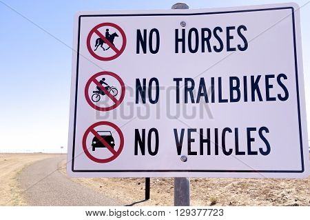 No Horses, No Trailbikes, No Vehicles sign in outback Australia.