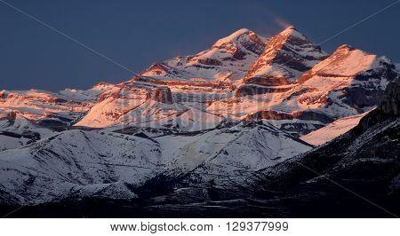 Sunset in snowy mountain, Ordesa National Park, Pyrenees, Huesca, Aragon, Spain.