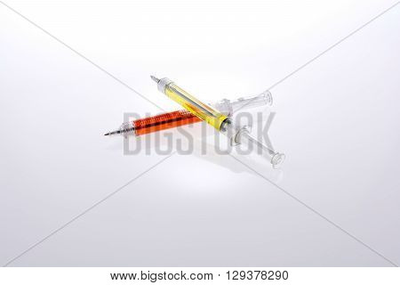 Surgical needle pens with colorful liquid on white background