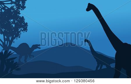 Silhouette of brachiosaurus and spinosaurus at the night