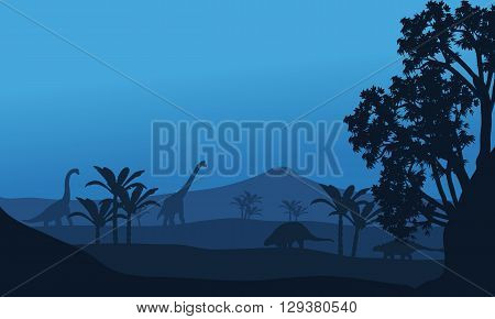 Silhouette of ankylosaurus and brachiosaurus at the night