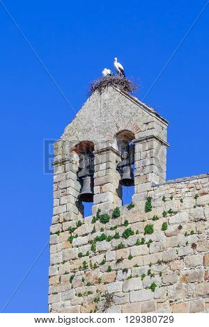 White Stork nest with the couple on it, on top of the belfry of the Flor da Rosa Monastery. Belonged to the Hospitaller Knights (aka Malta Order). Pousada de Portugal / Historical Inn of Portugal.