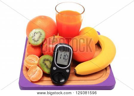 Glucose meter fresh ripe natural fruits and glass of juice on cutting board concept for diabetes healthy nutrition and strengthening immunity