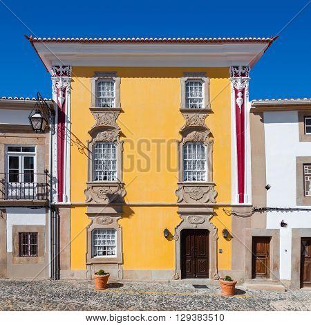Facade of The Magessi House, also known as Yellow House, a small hotel in Castelo de Vide. Portalegre, Alto Alentejo, Portugal