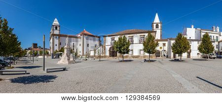 Dom Pedro V Square in Castelo de Vide. Santa Maria da Devesa church (left) and City-Hall (center). Alto Alentejo, Portugal