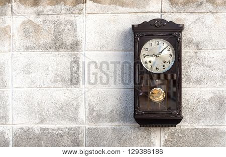Antique wall clock with a pendulum background