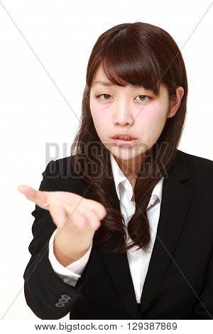 portrait of angry businesswoman requests something on white background