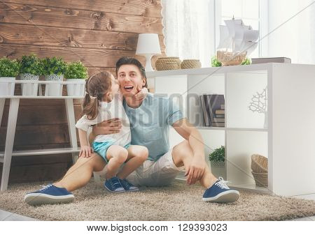 Happy loving family. Father and his daughter child girl playing and hugging. Concept of Father's day.