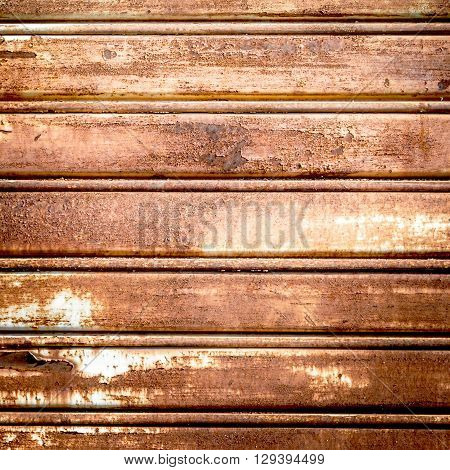 Background photo of a rusty old iron rolling shutter